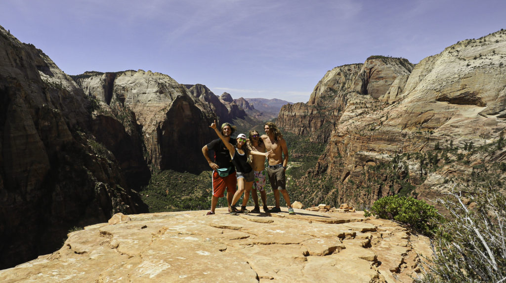 Briana and friends standing at the top of Angels Landing with the grand view