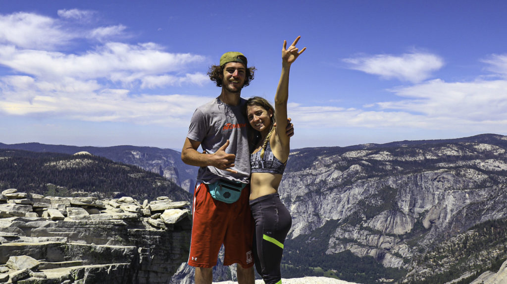 Billy and Briana take a victorious picture at the top of half dome