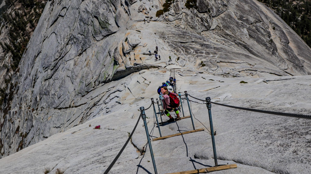 Briana hiking back down the Half Dome cables