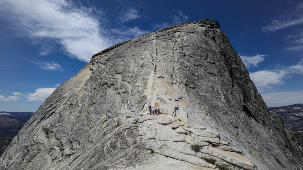 People hiking up the cables on half dome